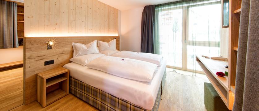 italy_dolomites_selva_mountain-design-hotel-eden_comfort-bedroom.jpg